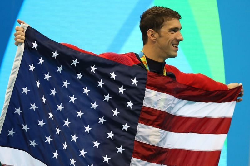 Gold medalist Michael Phelps of the United States poses during the medal ceremony for the Men