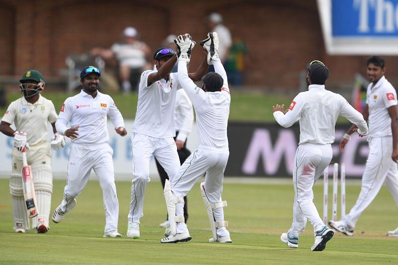 Sri Lanka cricket team celebrating a fall of wicket.