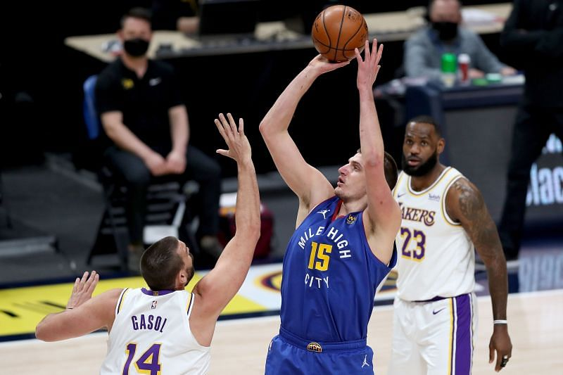 Nikola Jokic #15 of the Denver Nuggets puts up a shot over Marc Gasol #14 of the Los Angeles Lakers in the first quarter at Ball Arena on February 14, 2021 in Denver, Colorado. (Photo by Matthew Stockman/Getty Images)