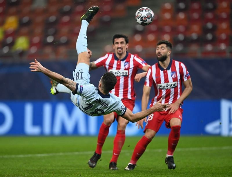 Olivier Giroud (air-borne) scored a stunner at Atletico Madrid on Tuesday.