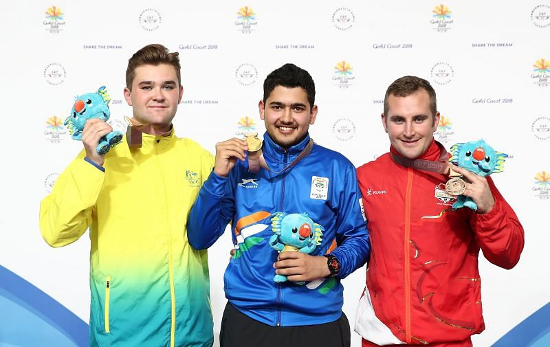 Anish Bhanwala poses with gold medal in the 25m Rapid pistol at 2018 Commonwealth Games