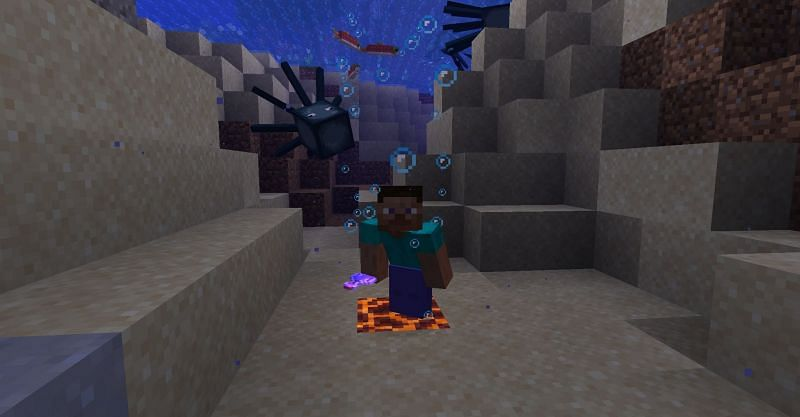 Steve standing on a magma block that is underwater in Minecraft. (Image via Minecraft)