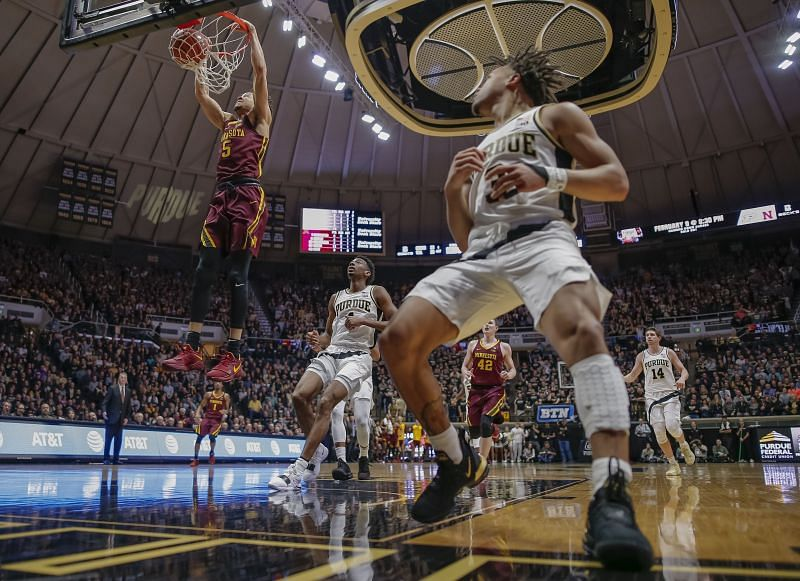 Amir Coffey #5 of the Minnesota Golden Gophers dunks the ball as Carsen Edwards #3 of the Purdue Boilermakers