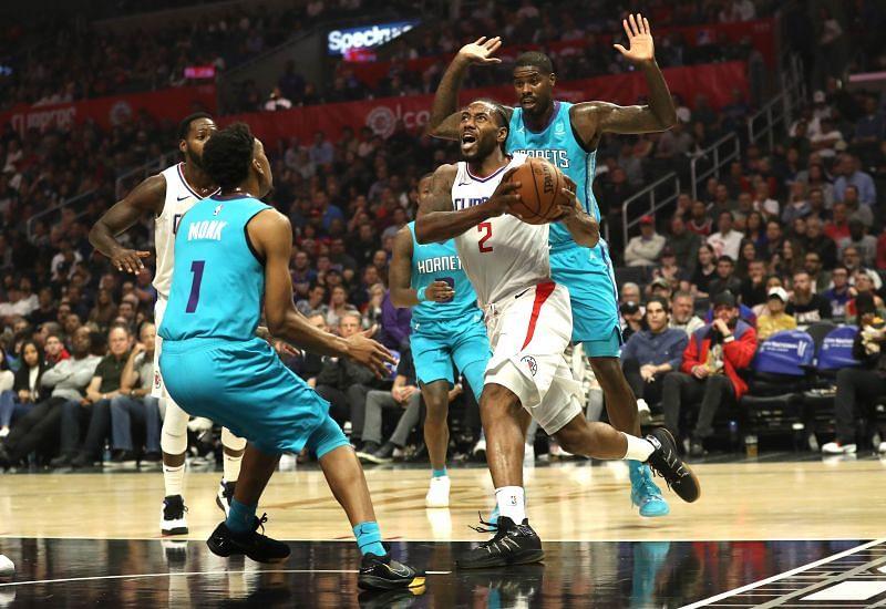 Kawhi Leonard #2 drives to the basket as Malik Monk #1 and Bismack Biyombo #8 defend. (Photo by Sean M. Haffey/Getty Images)