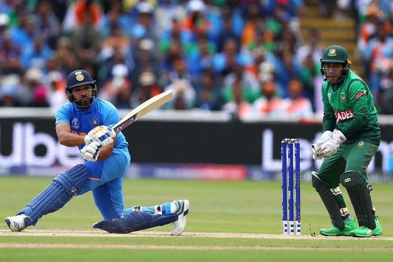 Rohit Sharma employs the sweep shot to put pressure on the spinners