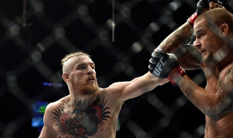 Conor McGregor (left) and Dustin Poirier (right) at UFC 178
