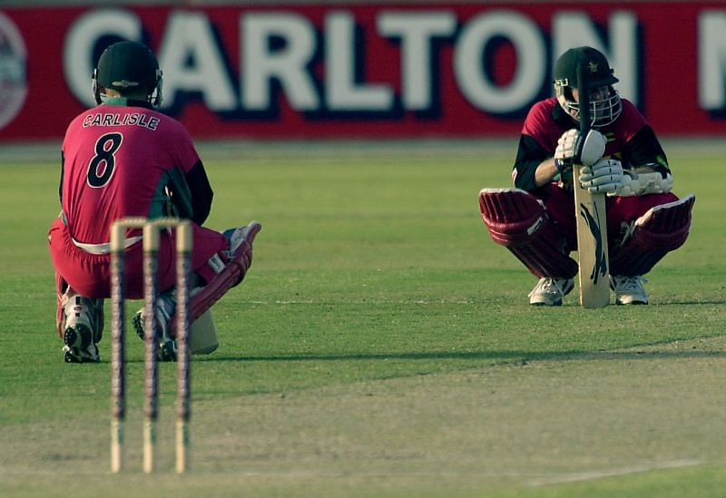 Stuart Carlisle and Grant Flower in the middle of their fighting knocks for Zimbabwe