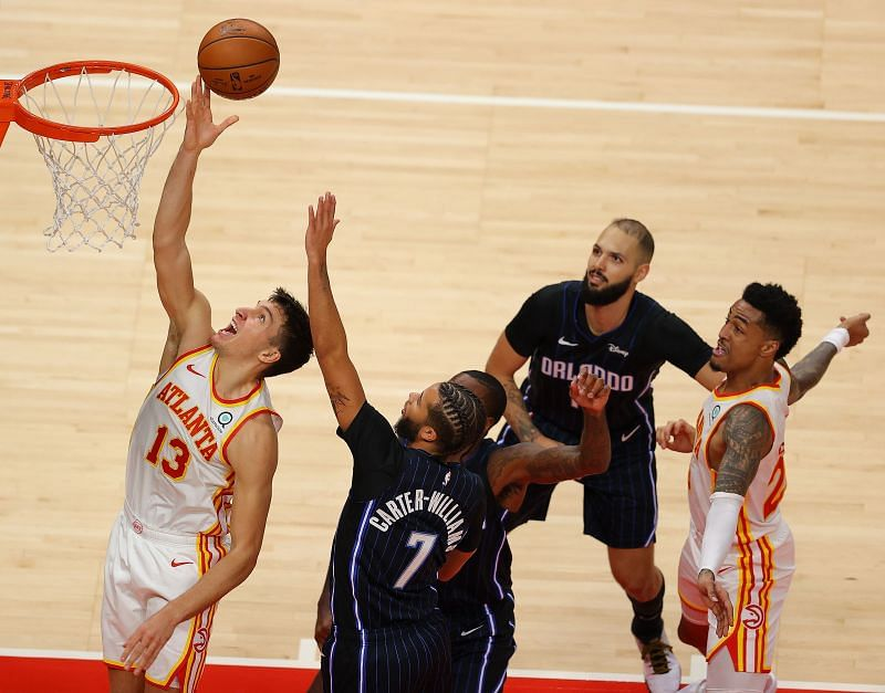 Bogdan Bogdanovic of the Atlanta Hawks lays it in against Michael Carter-Williams of the Orlando Magic