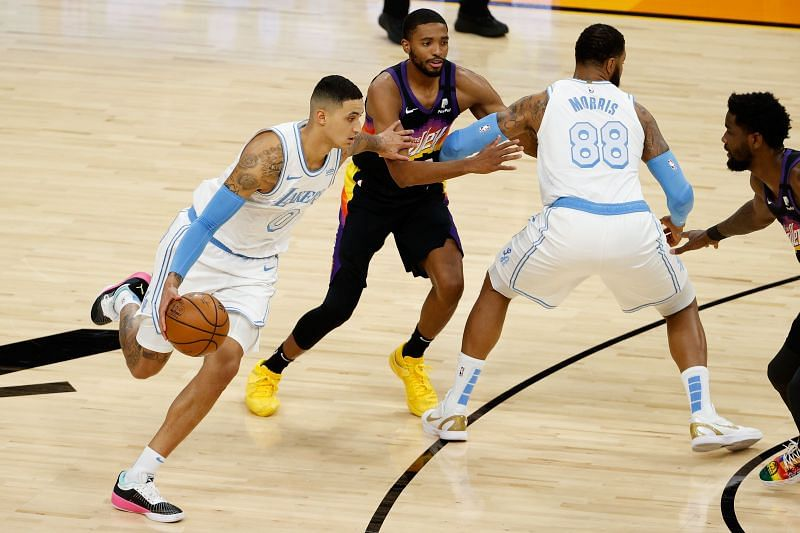 Kyle Kuzma #0 handles the ball ahead of Mikal Bridges #25. (Photo by Christian Petersen/Getty Images)