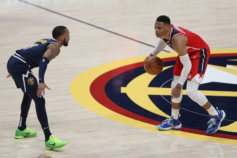 Russell Westbrook #4 is guarded by Monte Morris #11. (Photo by Matthew Stockman/Getty Images)