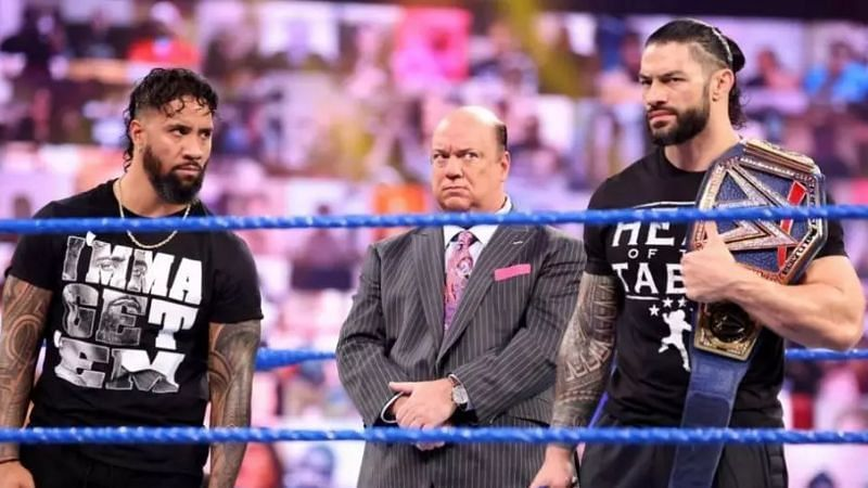 Jey Uso, Paul Heyman, and Roman Reigns.