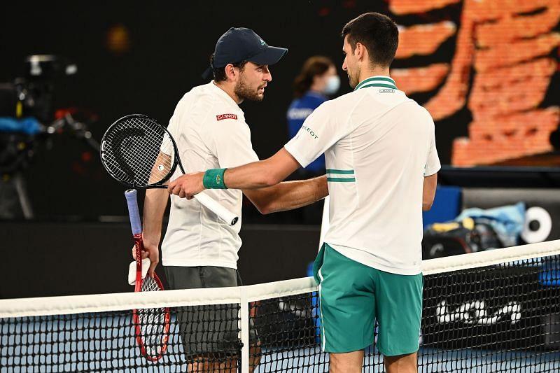 Aslan Karatsev (L) and Novak Djokovic after their 2021 Australian Open semifinal