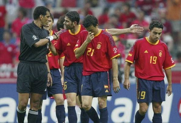 Spain protest one of several controversial refereeing decisions on the day