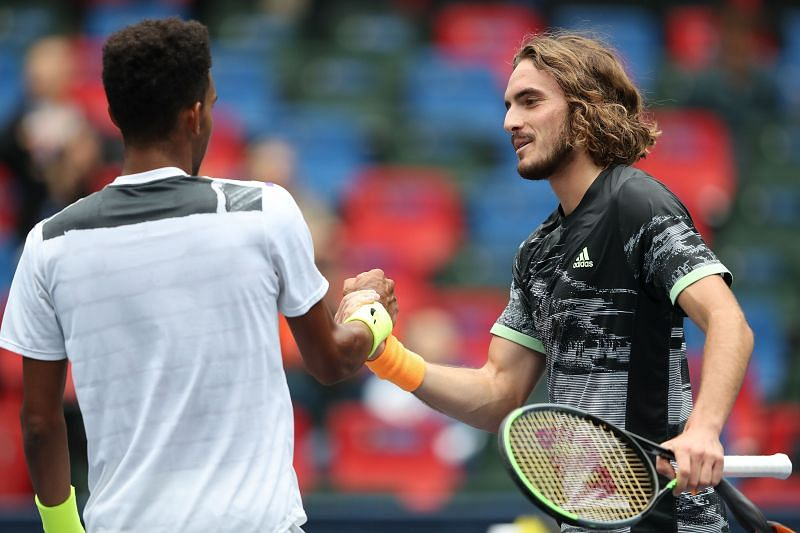 Stefanos Tsitsipas and Felix Auger-Aliassime shake hands after their match at Shanghai
