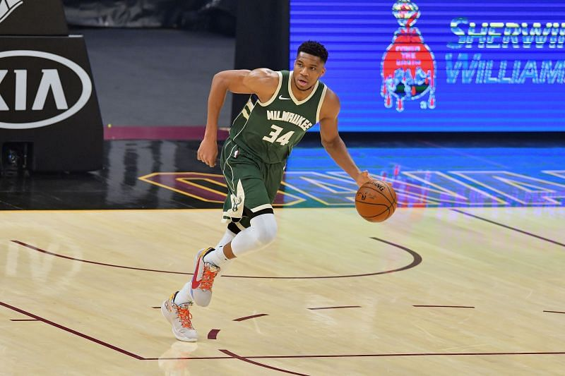 Giannis Antetokounmpo #34 of the Milwaukee Bucks brings the ball up court