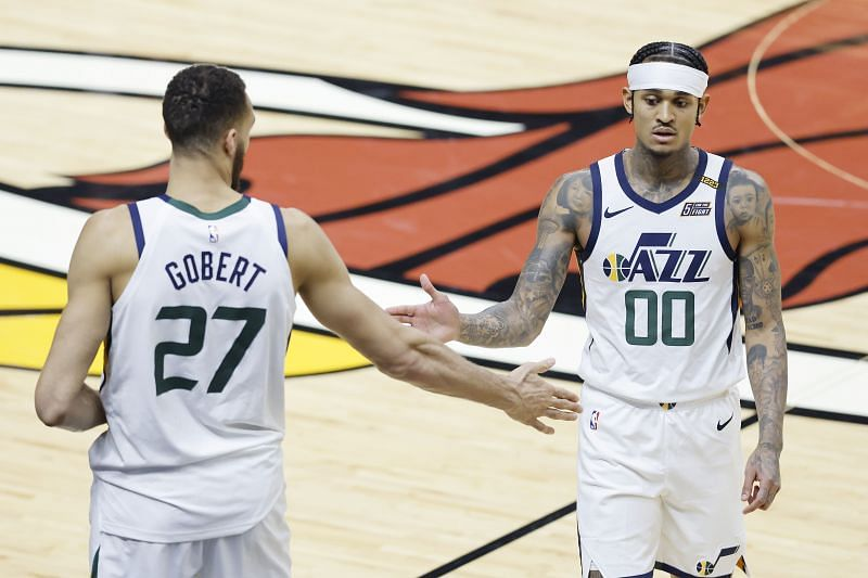 Rudy Gobert (#27) and Jordan Clarkson (#00) of the Utah Jazz