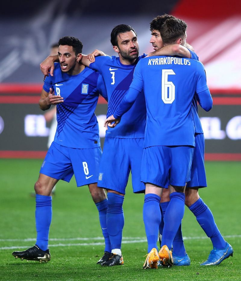Greece players celebrate after equalizing against Spain