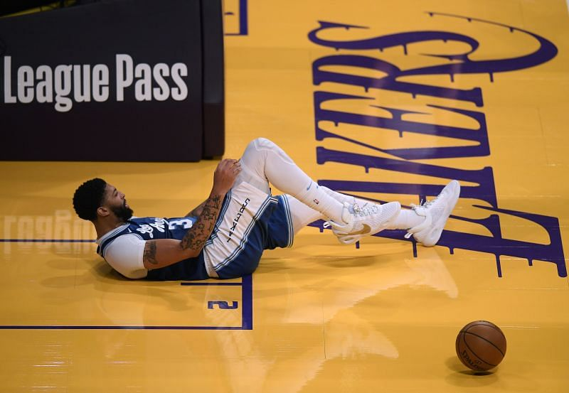 Anthony Davis #3 falls to the ground during the second half against the Denver Nuggets at Staples Center on February 04, 2021 in Los Angeles, California. (Photo by Harry How/Getty Images)