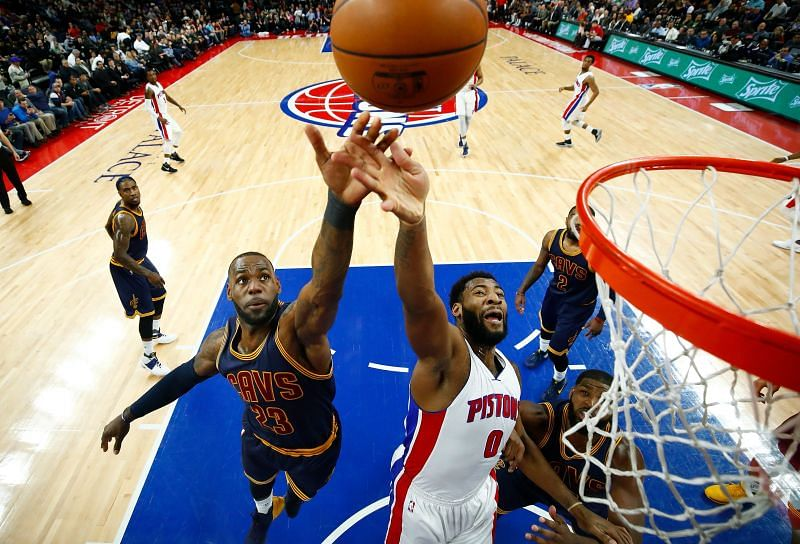 Andre Drummond (#0) and LeBron James (#23) battle for a first-half rebound