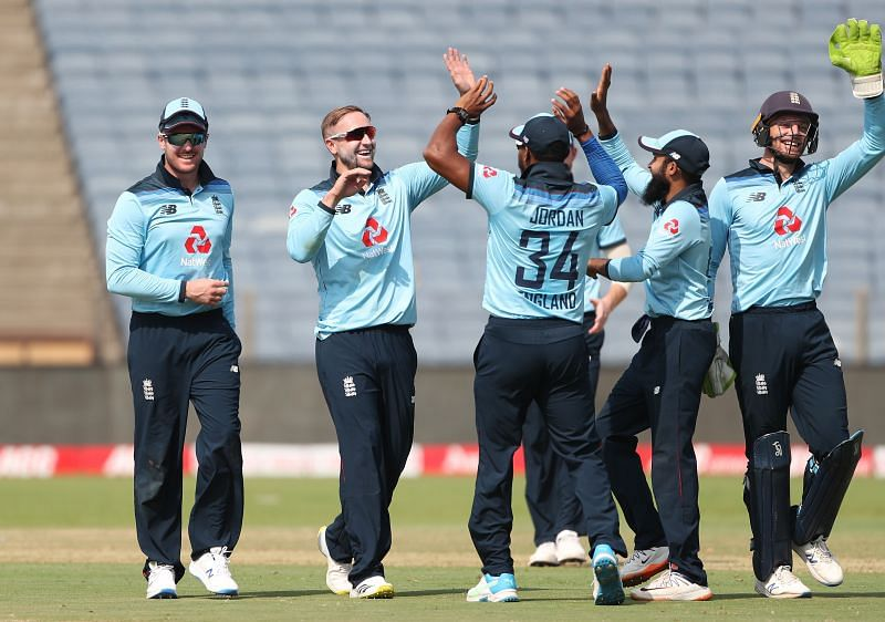 Team England celebrating a fall of wicket.