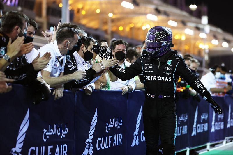 An elated Mercedes camp celeberate Hamilton