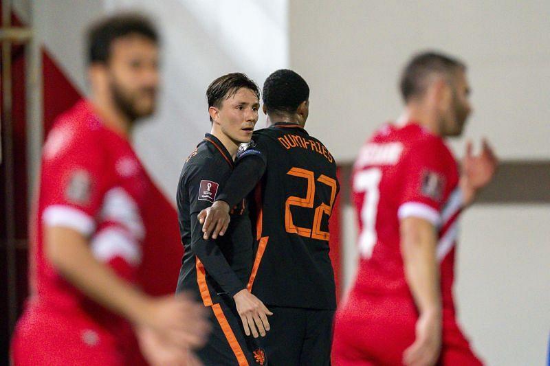 Steven Berghuis celebrates after scoring a goal for Netherlands.