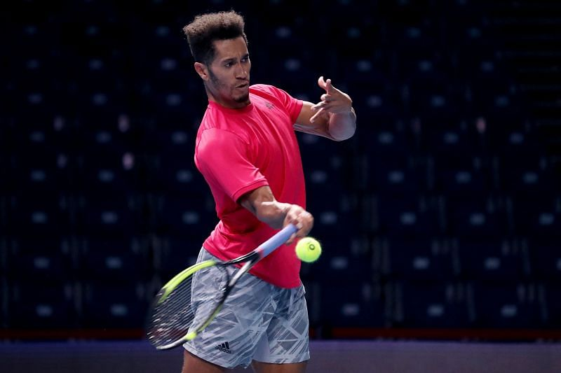 Michael Mmoh hits a forehand