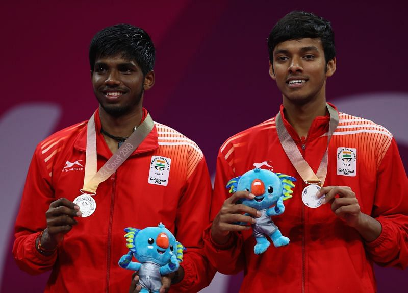 Satwiksairaj Rankireddy (L) and Chirag Shetty with the 2018 Commonwealth Games silver medal