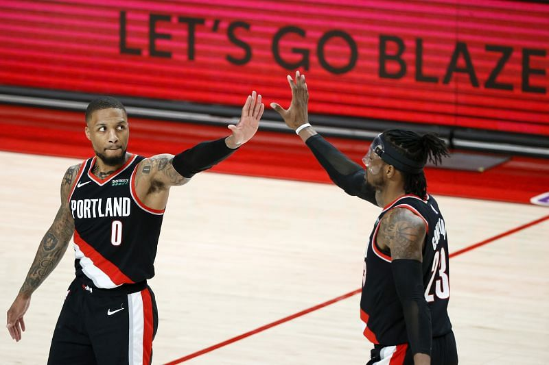 Damian Lillard #0 and Robert Covington #23 of the Portland Trail Blazers