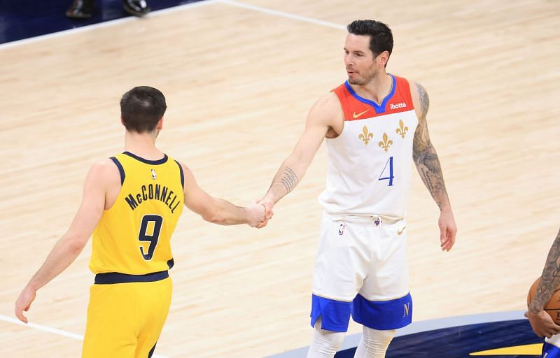 T.J. McConnell #9 and J.J. Redick #4 shake hands. Photo: Andy Lyons/Getty Images.
