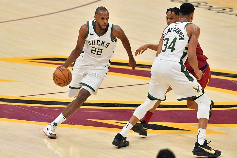 Khris Middleton #22 drives the ball against Isaac Okoro #35. (Photo by Jason Miller/Getty Images)
