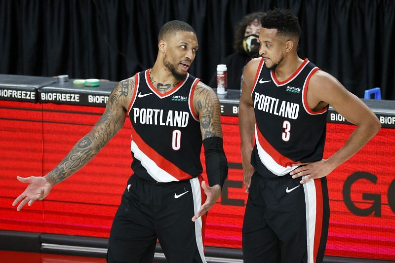 Damian Lillard #0 and CJ McCollum #3 talk during a stoppage in play. Photo: Steph Chambers/Getty Images.