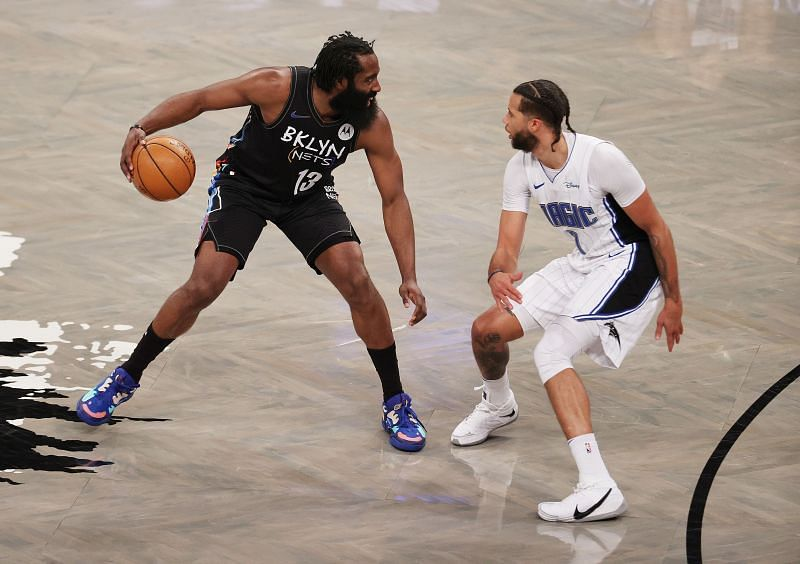 Michael Carter-Williams guarding James Harden of the Brooklyn Nets.