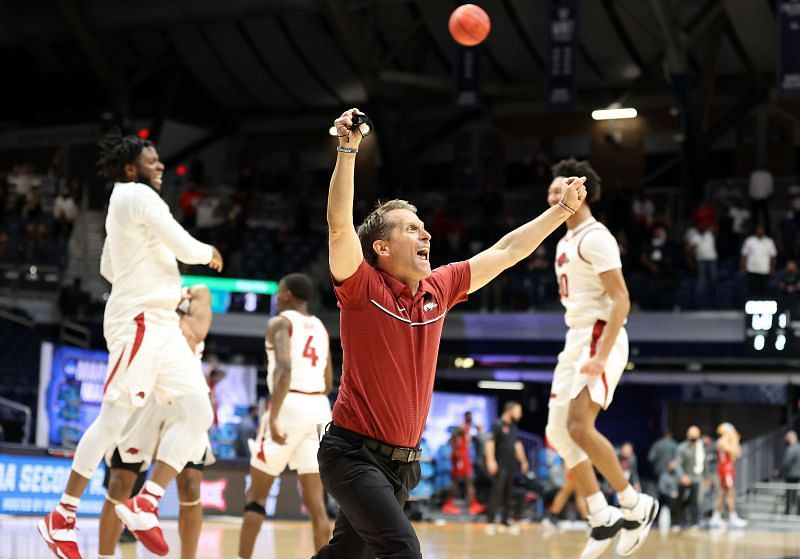 Arkansas Razorbacks head coach Eric Musselman celebrates 2nd round victory