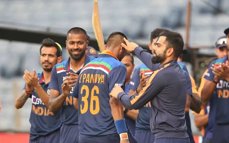 Krunal Pandya cheered by his teammates as he walks back to the pavilion