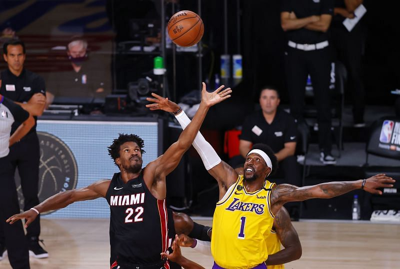 Jimmy Butler and Kentavious Caldwell-Pope fight for possession during game one of the 2020 NBA Finals.