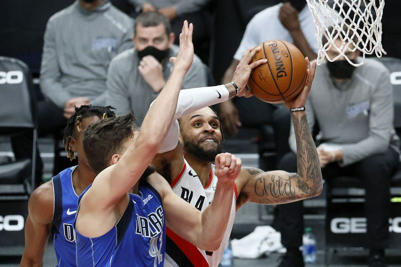 Gary Trent Jr. tries to finish closer to the rim