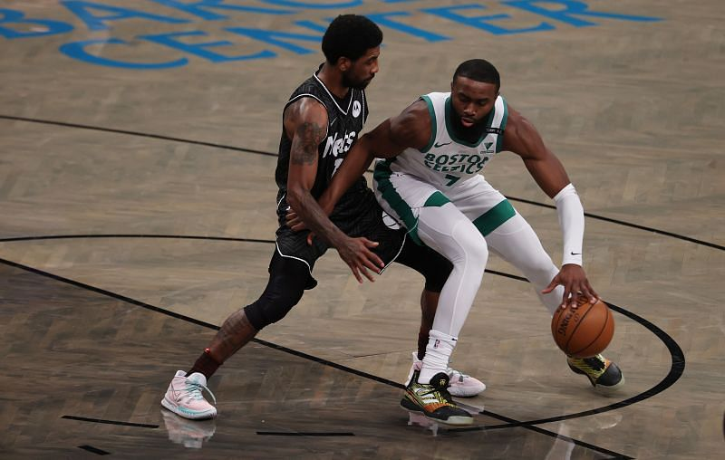 Boston Celtics star Jaylen Brown battles against Kyrie Irving of the Brooklyn Nets