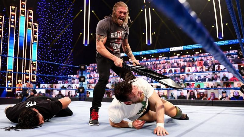 Edge menacingly attacked Daniel Bryan and Roman Reigns