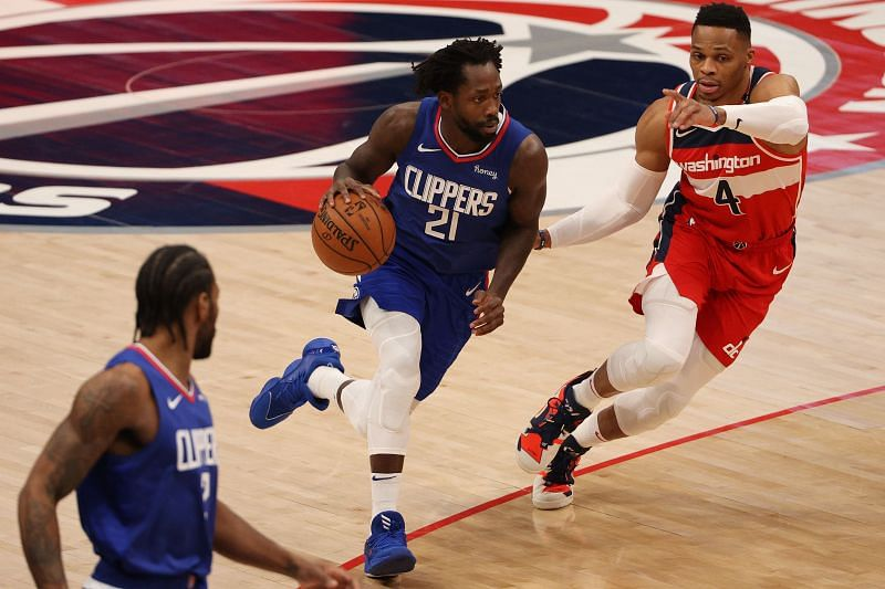Patrick Beverley #21 dribbles past Russell Westbrook #4. (Photo by Patrick Smith/Getty Images)