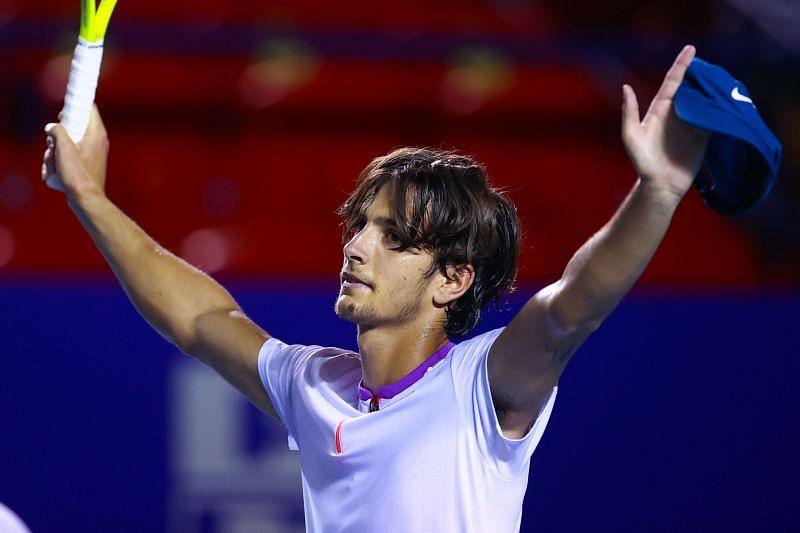 Lorenzo Musetti celebrates after beating Grigor Dimitrov