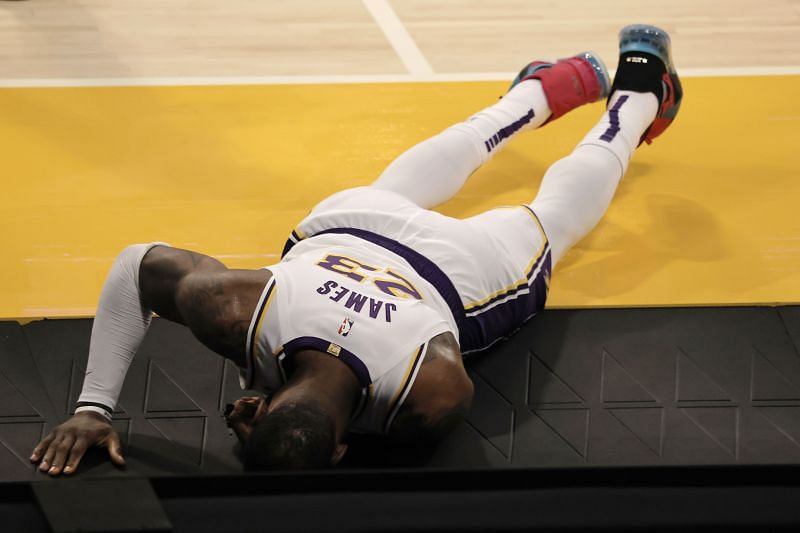 LeBron James #23 of the Los Angeles Lakers reacts to an injury against the Atlanta Hawks at Staples Center on March 20, 2021