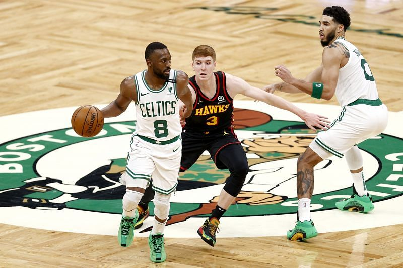 Kemba Walker #8 dribbles downcourt past Kevin Huerter #3. (Photo by Maddie Meyer/Getty Images)