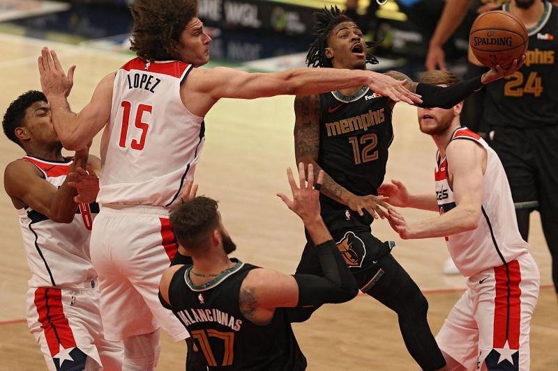 Ja Morant #12 of the Memphis Grizzlies shoots in front of Robin Lopez #15 of the Washington Wizards