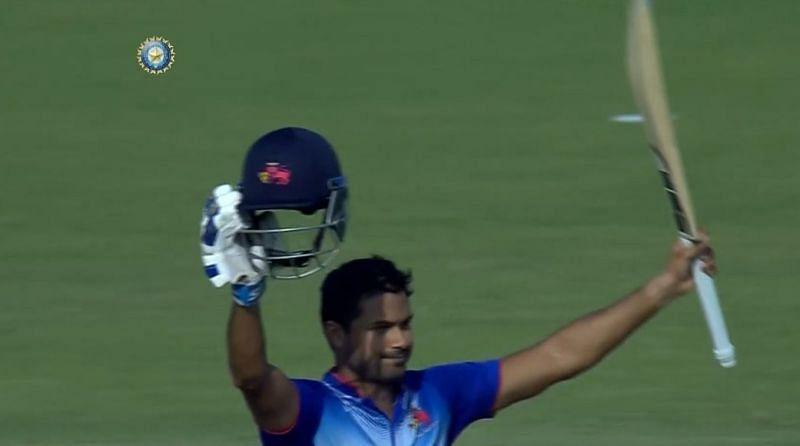 Aditya Tare celebrates his first List A hundred.