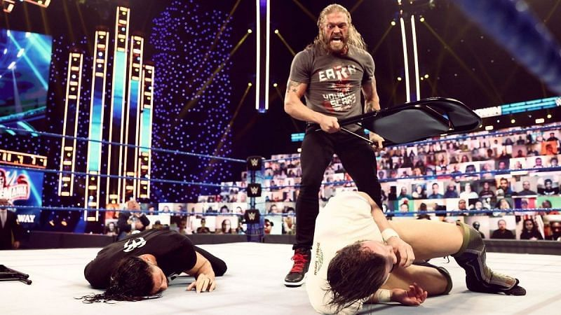 Edge assaults Roman Reigns & Daniel Bryan on SmackDown (Credit: WWE)
