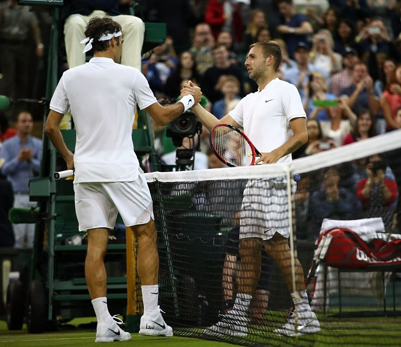 Roger Federer shakes hands with Dan Evans during their third round match at Wimbledon 2016