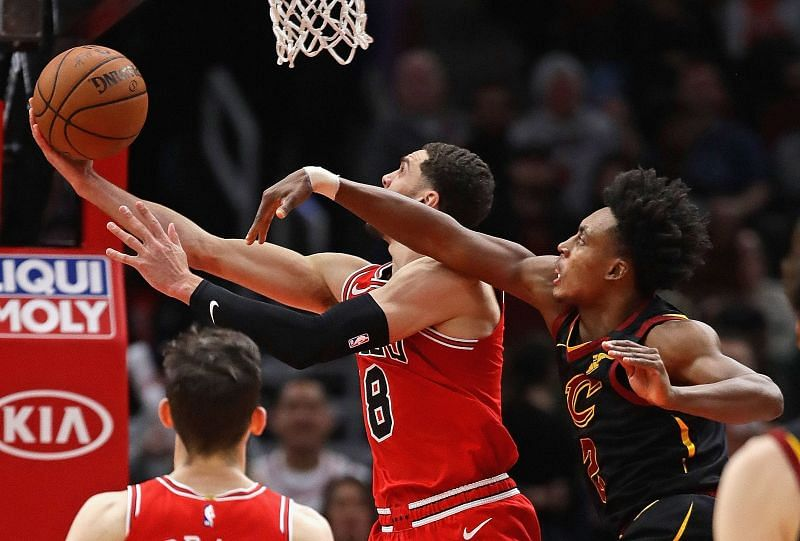 Zach LaVine #8 shoots the game-winning shot and is fouled by Collin Sexton #2. Photo: Jonathan Daniel/Getty Images.
