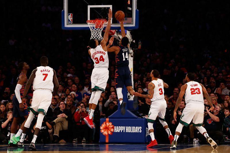 Giannis Antetokounmpo #34 of the Milwaukee Bucks blocks a shot by Allonzo Trier #14 of the New York Knicks