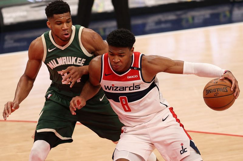 Rui Hachimura #8 dribbles in front of Giannis Antetokounmpo #34. (Photo by Patrick Smith/Getty Images)